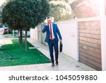 modern young businessman going... | Shutterstock . vector #1045059880