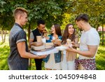 friends eating and having fun.... | Shutterstock . vector #1045094848