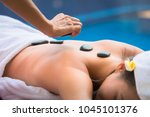 spa stone massage concept ... | Shutterstock . vector #1045101376