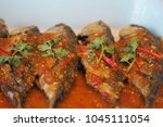 fried fish in spicy thai's style | Shutterstock . vector #1045111054