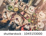 group of people having meal... | Shutterstock . vector #1045153000