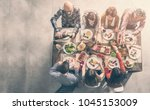 group of people having meal... | Shutterstock . vector #1045153009