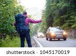 female tourist with backpack... | Shutterstock . vector #1045170019