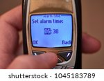 setting up alarm on an old...   Shutterstock . vector #1045183789