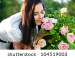 Stock photo beautiful woman in garden with roses 104519003