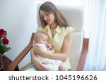young mother holding her baby ... | Shutterstock . vector #1045196626