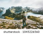 man hiking in mountains... | Shutterstock . vector #1045226560