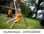 Panned Shot Of A Young Girl On...