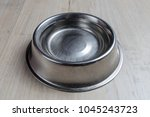 steel dog bowl with water on... | Shutterstock . vector #1045243723