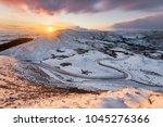 long winding rural road in the... | Shutterstock . vector #1045276366