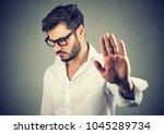 annoyed sad man giving talk to... | Shutterstock . vector #1045289734