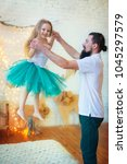 daddy throws up her daughter | Shutterstock . vector #1045297579