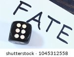 Small photo of inscription fate and dice