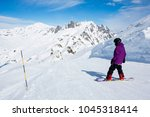 a snowboarder in purple jacket... | Shutterstock . vector #1045318414
