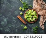 brussels sprouts on green... | Shutterstock . vector #1045319023