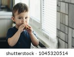 beautiful baby sitting in the... | Shutterstock . vector #1045320514