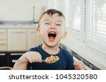 beautiful cute baby eats rice... | Shutterstock . vector #1045320580