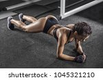young woman doing plank... | Shutterstock . vector #1045321210