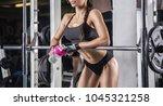 fitness girl with shaker posing ... | Shutterstock . vector #1045321258