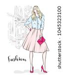 a tall  slender girl in a midi... | Shutterstock .eps vector #1045323100