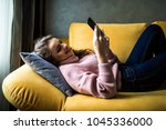 close up of a relaxed girl... | Shutterstock . vector #1045336000