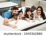 happy family is relaxing on... | Shutterstock . vector #1045362880