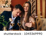 happy young couple taking... | Shutterstock . vector #1045369990
