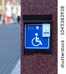 Small photo of Handicapped access entrance pad mounted to a wall. Sign a button for a visa for people with disabilities