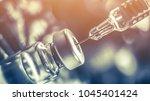 vaccine vial dose flu shot drug ... | Shutterstock . vector #1045401424