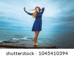 ginger tatooed girl and sea | Shutterstock . vector #1045410394