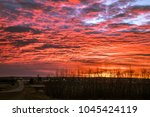 red clouds just before sunrise  ... | Shutterstock . vector #1045424119