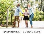 happy family having fun... | Shutterstock . vector #1045434196
