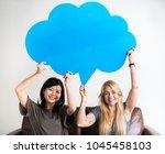 happy asian and caucasian women ... | Shutterstock . vector #1045458103