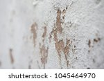 Small photo of Close up White concrete wall abrasion texture background