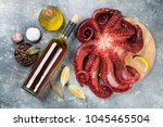 raw octopus cooking with spices ... | Shutterstock . vector #1045465504