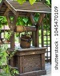 A Wooden Well In Garden. ...