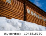 wooden house and snowbank... | Shutterstock . vector #1045515190