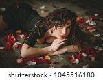 beautiful girl. rose petals.... | Shutterstock . vector #1045516180