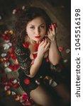 beautiful girl. rose petals.... | Shutterstock . vector #1045516198