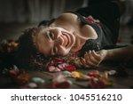 beautiful girl. rose petals.... | Shutterstock . vector #1045516210