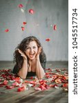 beautiful girl. rose petals.... | Shutterstock . vector #1045517734