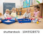 group of children playing in...   Shutterstock . vector #1045528573