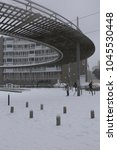 Small photo of View of the round point located in Marcel Godechot street, in Montpellier city France, during a very snowy day: 28th february 2018. Decorative steel circular structure. People walking on the snow.