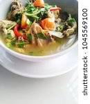 chicken sour soup with herb | Shutterstock . vector #1045569100