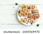 grilled shrimp skewers. seafood ... | Shutterstock . vector #1045569970