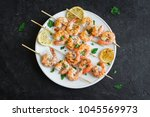 grilled shrimp skewers. seafood ... | Shutterstock . vector #1045569973
