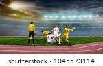 soccer ball on the field of... | Shutterstock . vector #1045573114