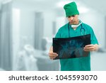 surgical doctor examining xray... | Shutterstock . vector #1045593070