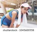 Small photo of Exhausted woman runner taking breath deeply after hard running session. Concept of woman health, sport breathing.