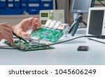 to repair the pcb of a modern... | Shutterstock . vector #1045606249